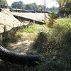 Drain pipes directed outside silt fence into woods.  Southwest quadrant of I-495/Rt 236 Rd interchange. 13 Oct 2010
